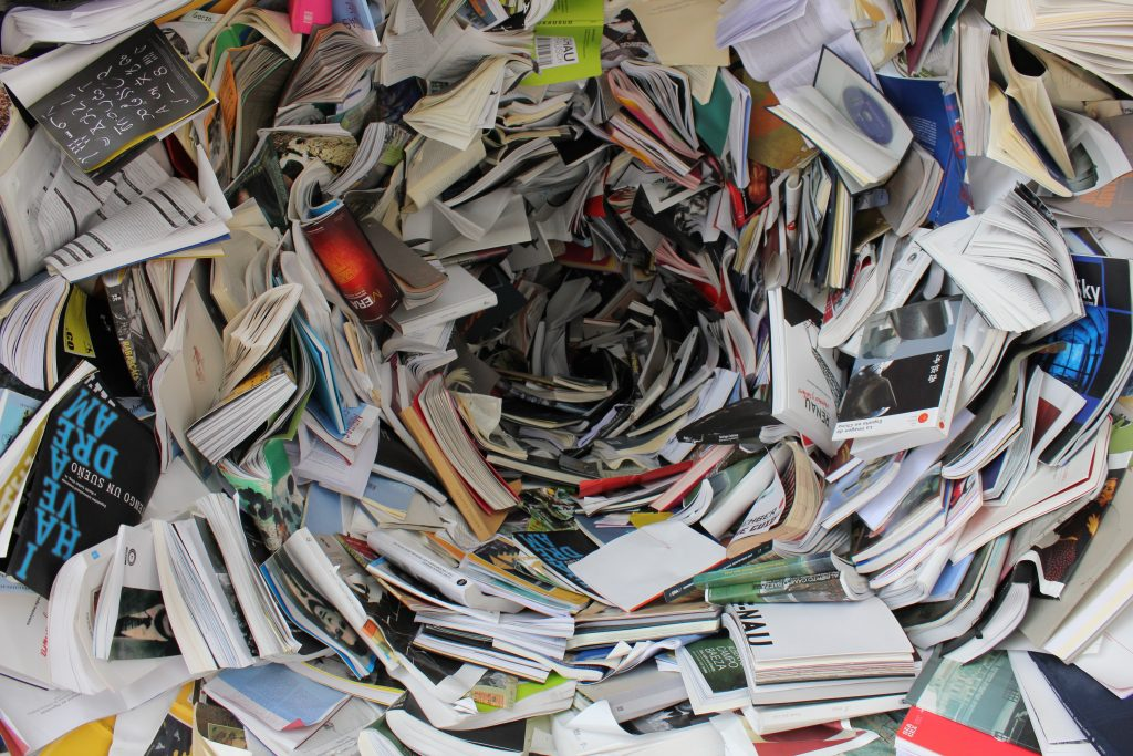 A pile of books and papers, to use when you pack your home.