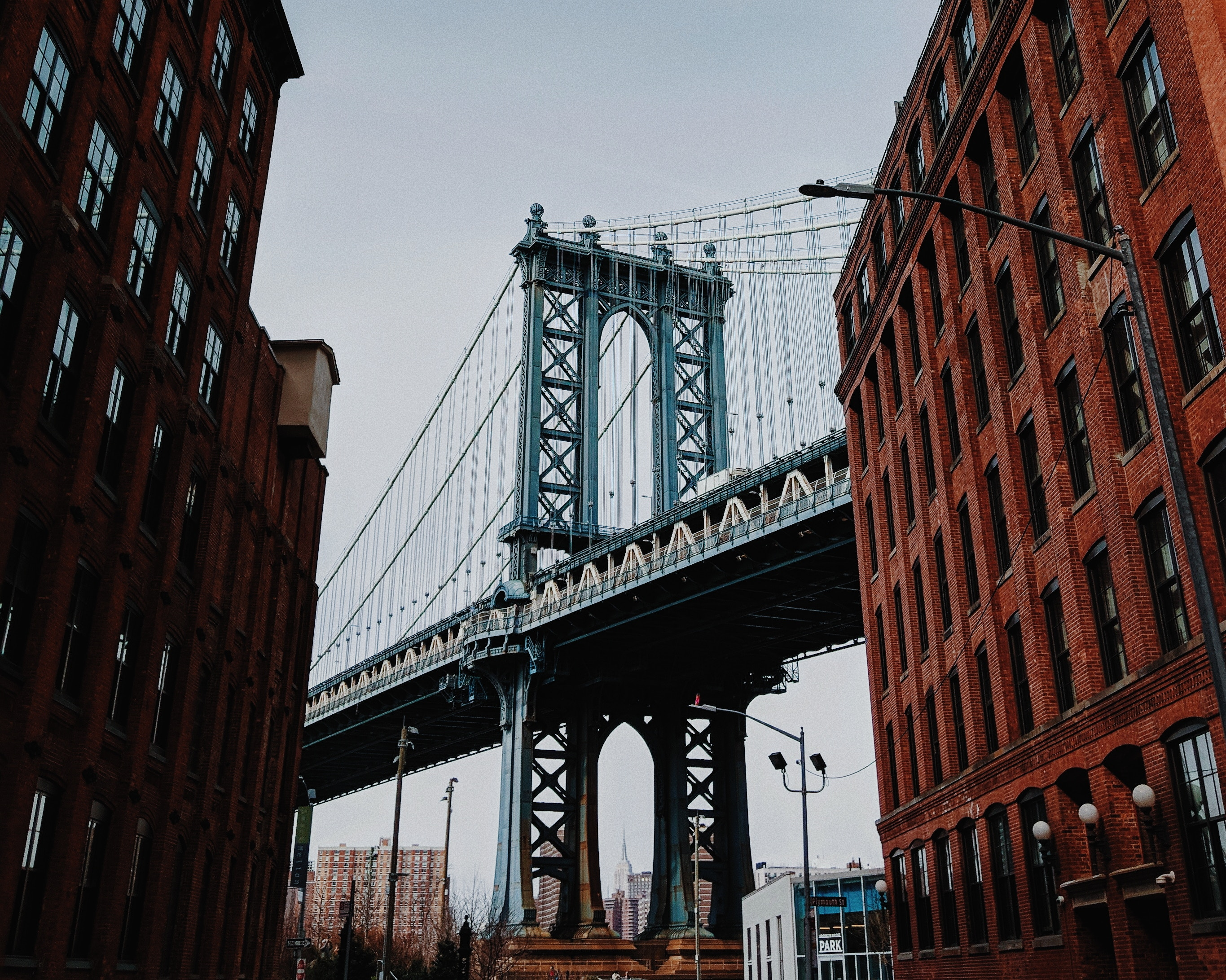 A view of the Brooklyn bridge from the street level.