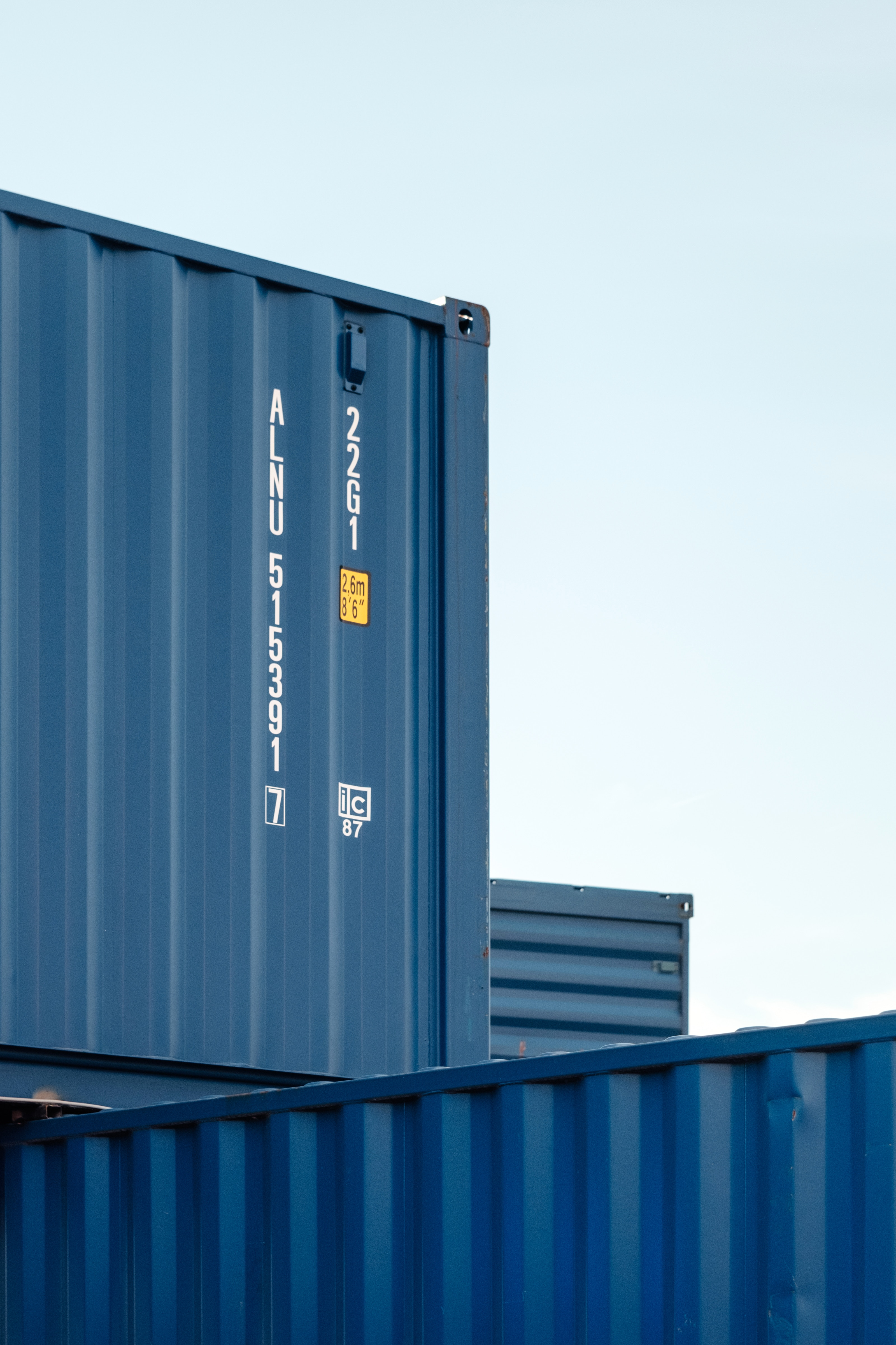 Blue storage containers stacked on top of each other.