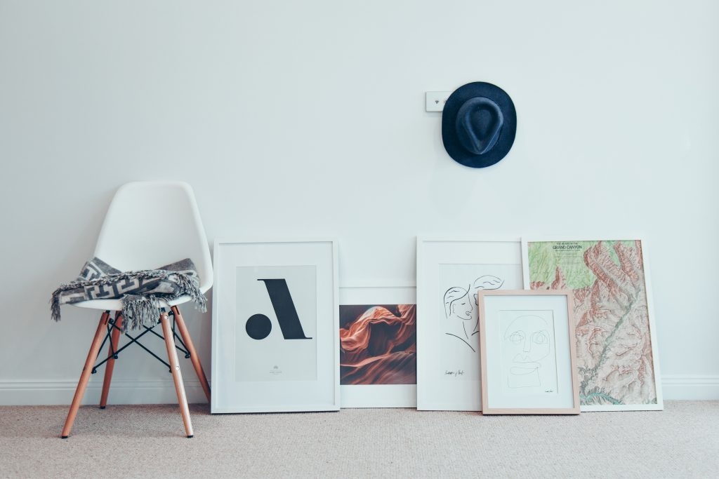 Several pieces of art lying on the floor against a wall. - something our Bay Ridge movers can help you with