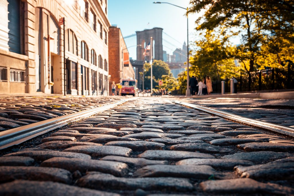 A gray brick road in Brooklyn. - art galleries in Brooklyn are in some of the best areas.