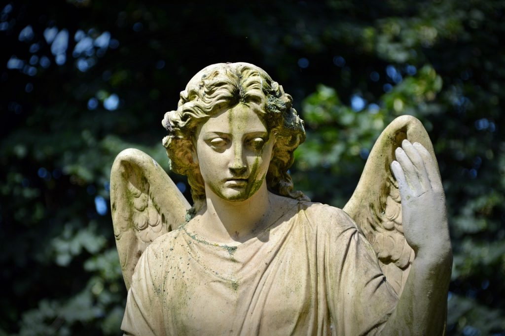 An angel statue making a bored face - it would have to be crated by statue movers NYC due to it's size.