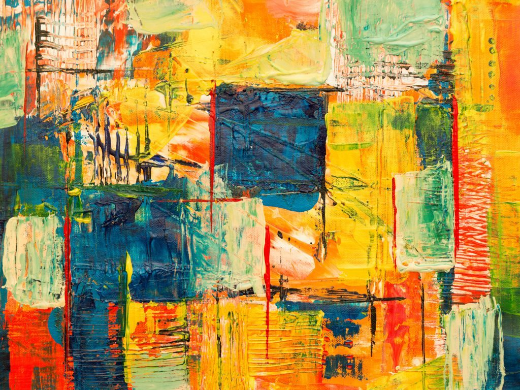 An abstract painting with blue and yellow hues and square shapes.