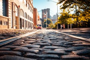 A view of the cobblestones with the Brooklyn bridge in the background. Brooklyn is the best place for you if you love exploring!