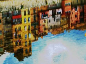 A painting of a skyline reflection in a pond, symbolizing the time when you prepare your paintings for a move.