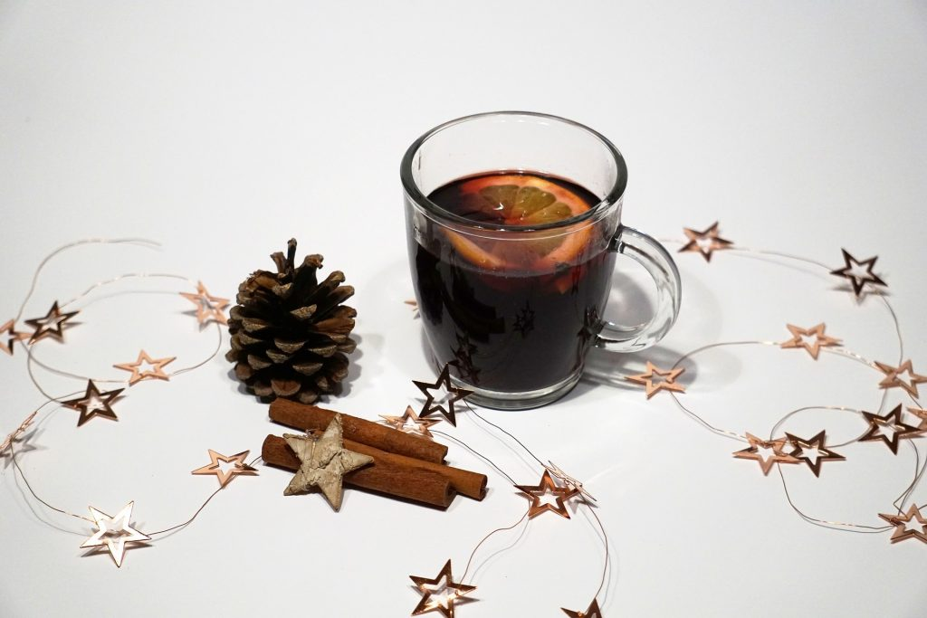 A cup of mulled wine with Christmas decorations.