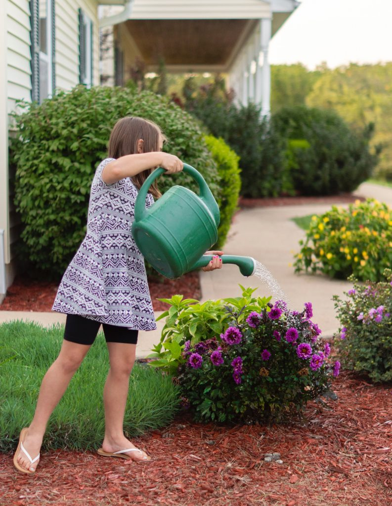 Girl gardening - something your kids can enjoy after moving to Flatbush