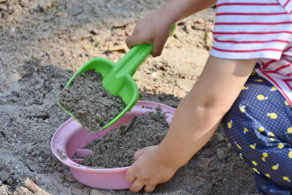 A child playing in the sand.
