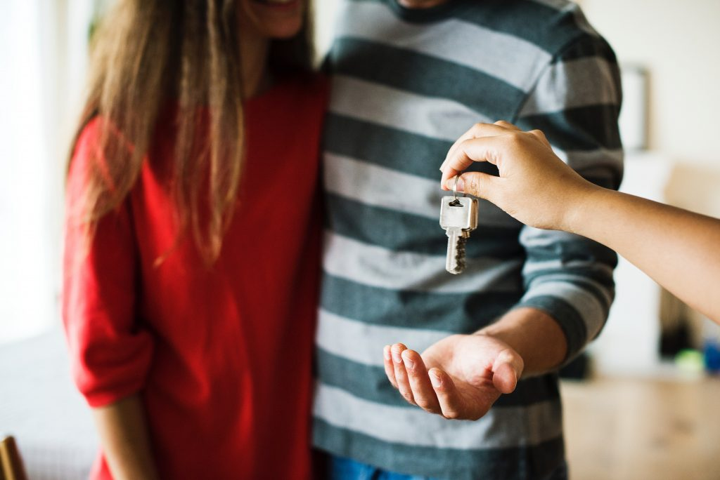A couple receives keys to their new home.