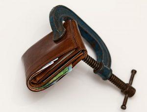 A wallet squeezed shut.