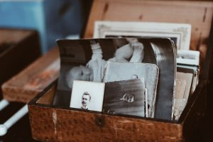 A chest full of old, black and white photographs.