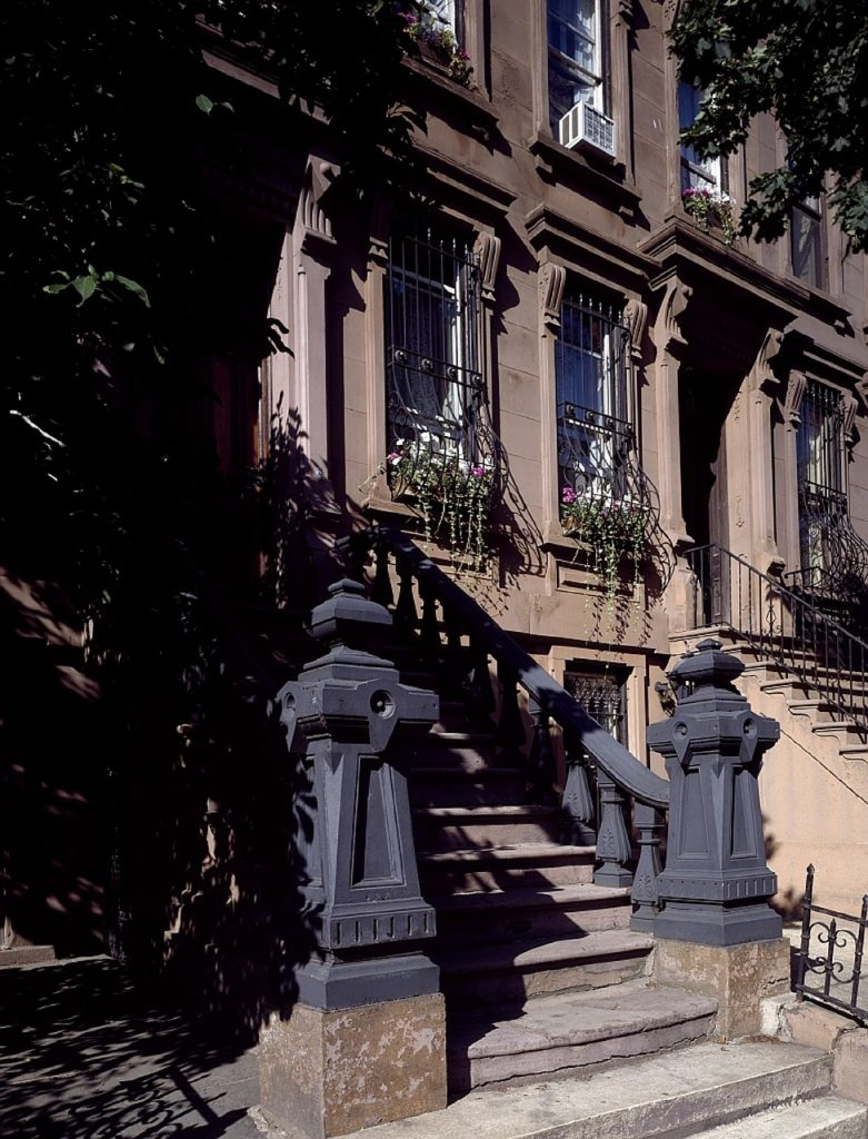A dramatic picture of a brownstone staircase.