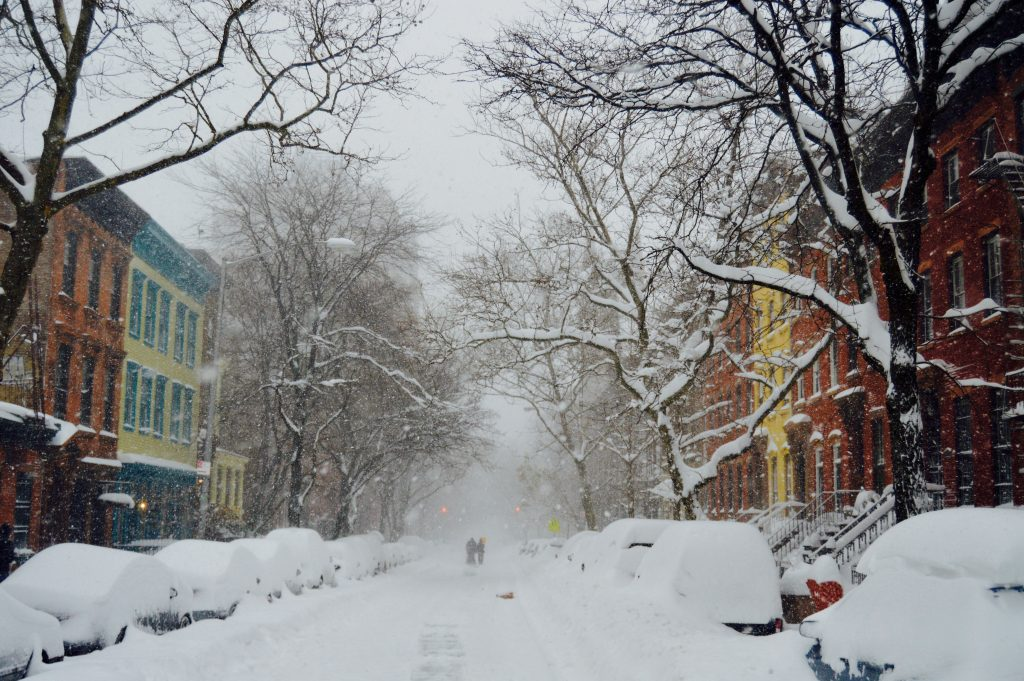 A snowed-in brownstone buildings