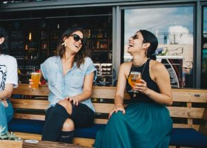 two girls drinking beer