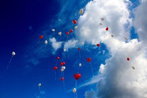 hear-shaped balloons in the sky