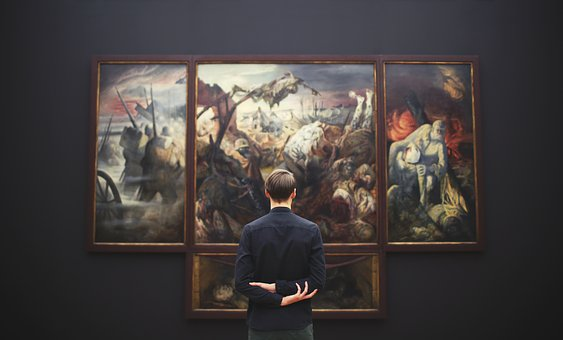 man in front of painting