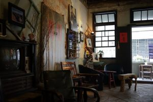 an old room with artwork in it, representing the best art galleries in Brooklyn