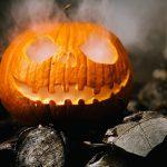 a pumpkin with a smoke