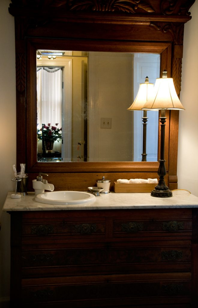 Mirrors can help you to use lighting to maximize your Gowanus apartment