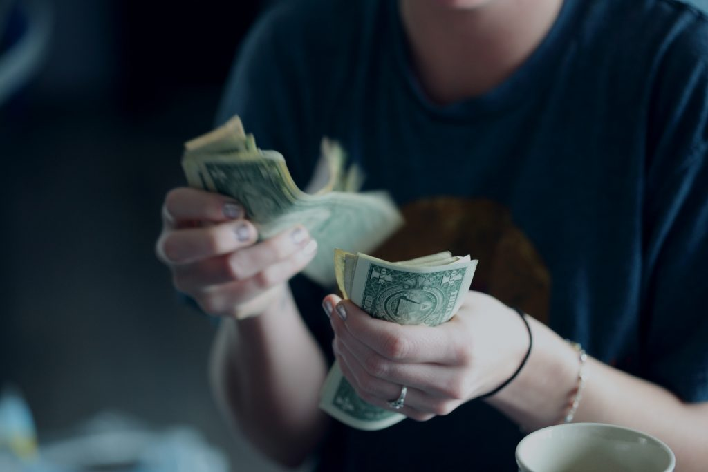 -hands counting money