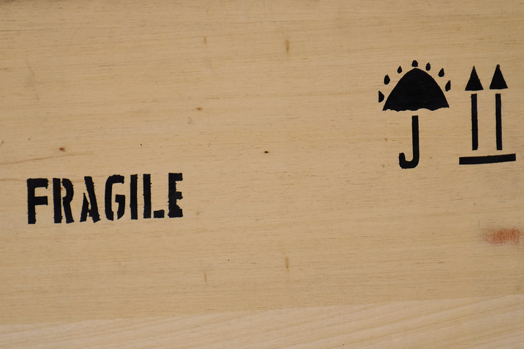Fragile Sign On A Box For Packing Pictures And Mirrors