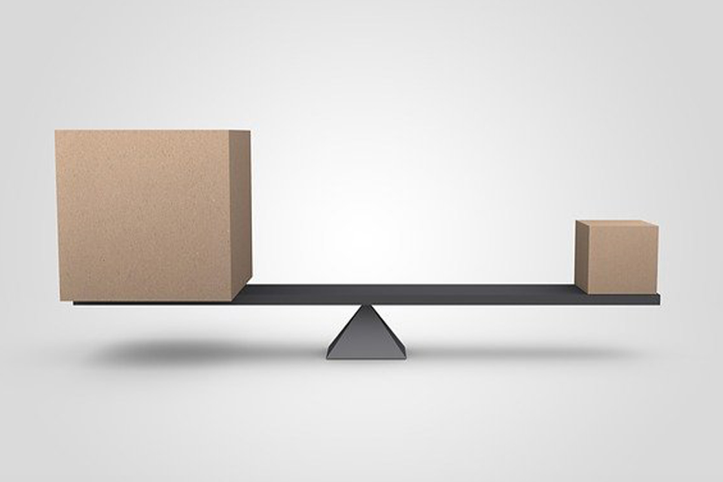 A big and a small box on a seesaw