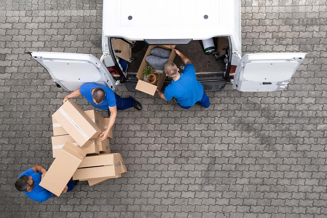Professional movers are loading a moving truck